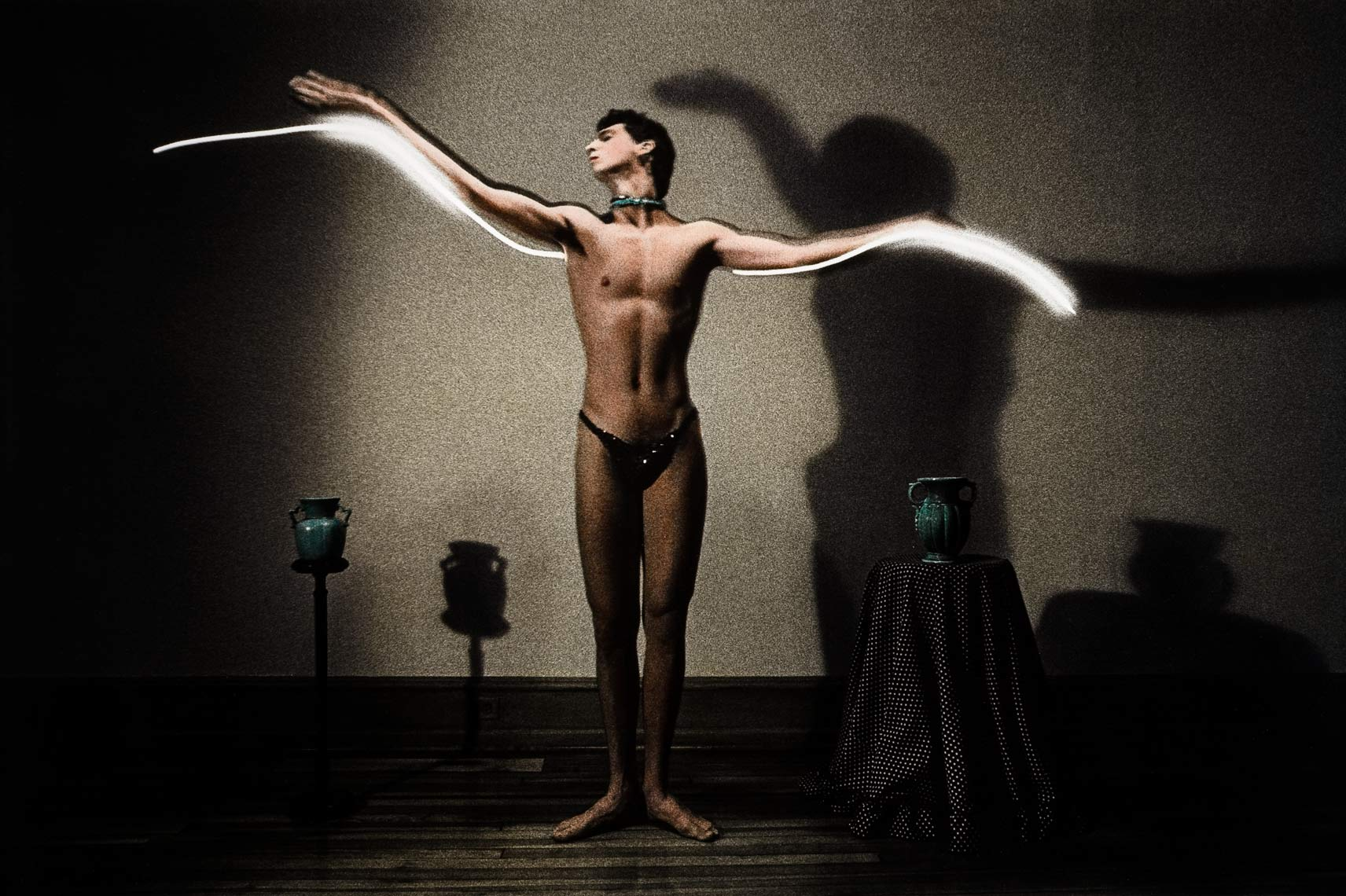 David Lebe; Flight, 1983, male nude, light drawing, hand colored photograph