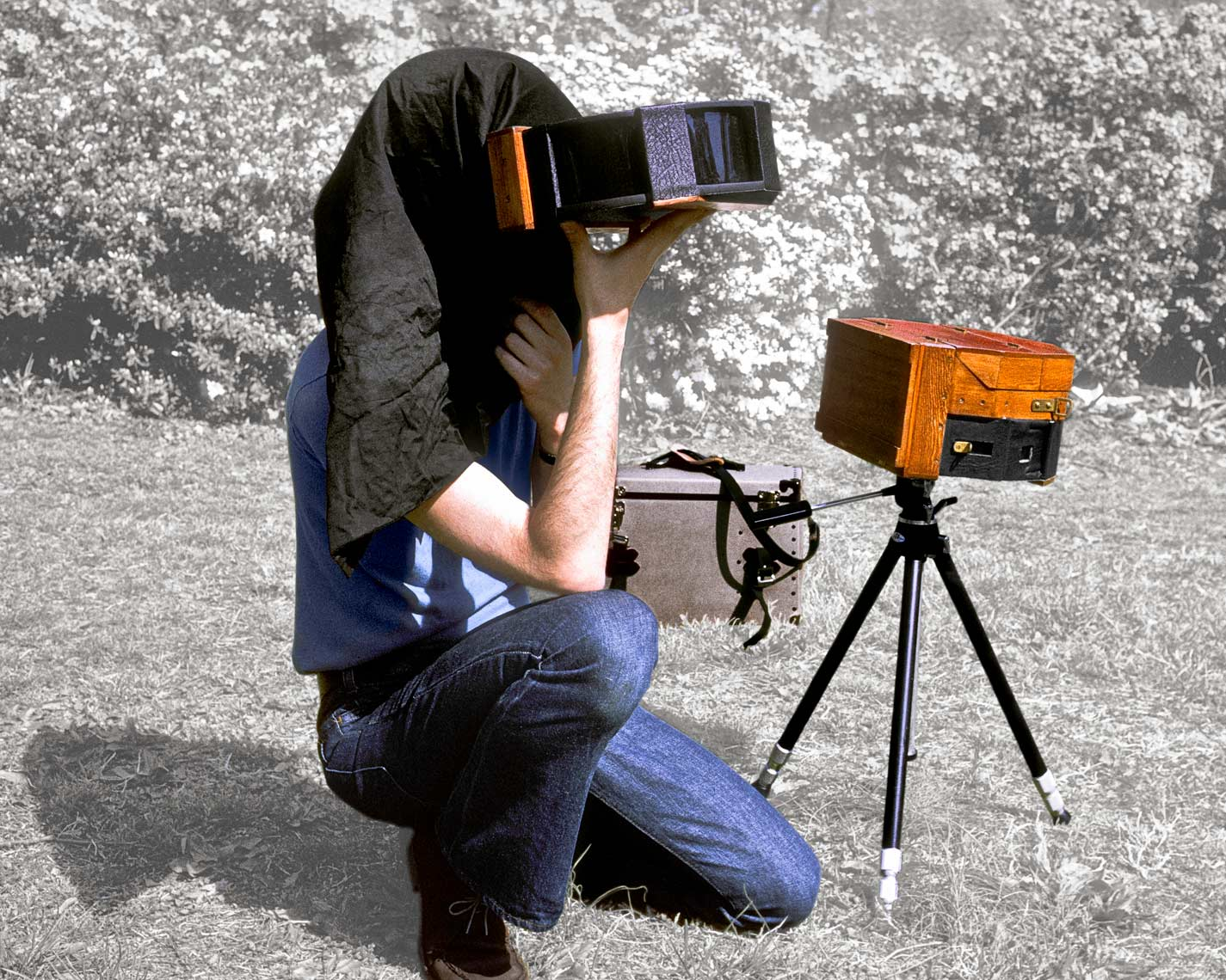 David Lebe using his pinhole viewfinder for 4 apature pinhole camerea, 1974
